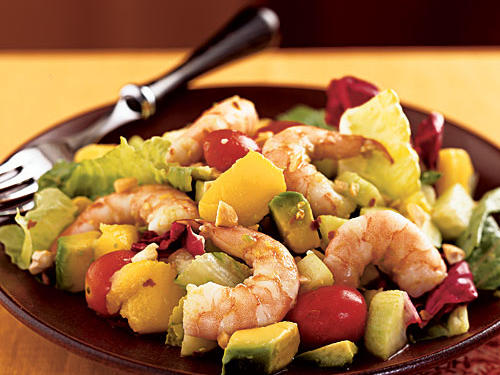 If you buy precooked shrimp from the grocery store, this is a completely no-cook recipe. The flavors of mango, cucumber, and tomato combine with rice vinegar to create a healthy and tasty dressing, while a topping of avocado and cashews adds creaminess and crunch. Other tropical fruits, like papaya, guava, starfruit, and even banana, would be welcome here.