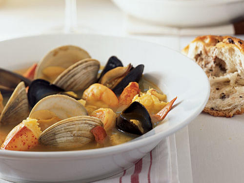The traditional seafood stew of Provence, a bouillabaisse is typically made with tomatoes, onions, wine, olive oil, garlic, herbs, fish and shellfish. Soak up the flavorful broth with Olive Bread or a crusty French baguette. While 8 cups of water doesn't seem like much, it's enough to steam the lobsters. If clams are unavailable, substitute an equal amount of mussels.