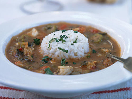 Traditionally gumbo starts with a roux - a mixture of flour and fat that's cooked slowly until browned. In this recipe, named for a small town in Louisiana, you brown the flour in the oven. This technique provides a deep, nutty flavor without the fat.