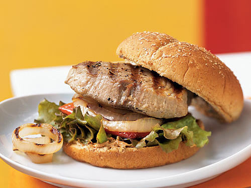 There's a lot to love about these sandwiches: the onion and pepper grilled to caramelized perfection, the melt-in-your-mouth medium-rare tuna steaks, the spicy-tangy-creamy mayonnaise, and even the crunchy lettuce leaf on each bun. This dish is a great source of omega-3s and other healthy fats, but it has less than two grams of saturated fat per serving.