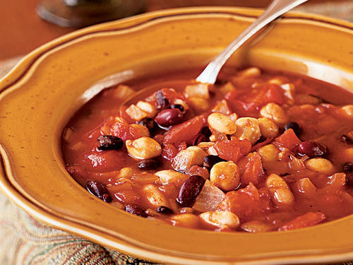 Boasting less than 300 calories and almost 15 grams of fiber per bowl, this hearty chili skips the ground beef and uses chickpeas, black beans, kidney beans, and cannellini beans for a protein boost. To make this a complete vegetarian meal, skip the Worcestershire sauce or use anchovy-free.