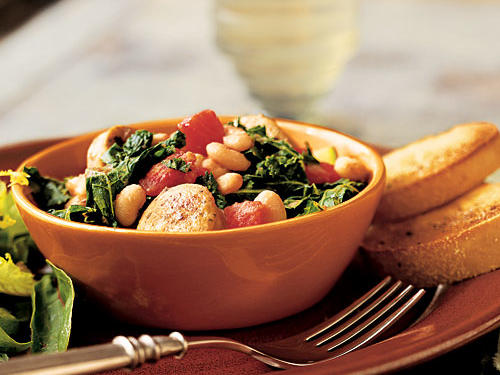 Don't be put off by the French name; this is a home-style stew that's easy as pie to make. The beans add a creaminess that's a great addition to the hearty potato and sausage. Bitter escarole provides a nice contrast, but you can use spinach or kale if you prefer something milder. Serve with crusty bread, or over a cooked whole grain like barley or farro.