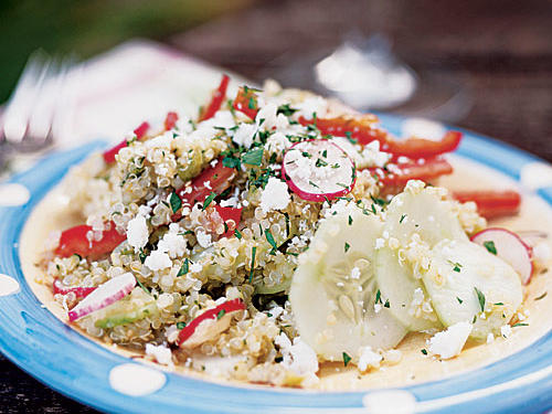 Quinoa combines with crisp, colorful vegetables and tart vinaigrette for a delicious main-dish salad. Creamy queso anejo balances the tartness of the dressing. Queso blanco or ricotta salata are good substitutes.