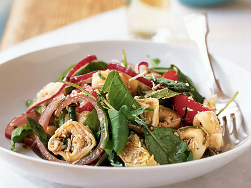 Extra virgin olive oil and two kinds of vinegar make an easy, classic dressing for this pasta-and-vegetable salad. You can also try this with chicken or mushroom tortellini or cheese ravioli.