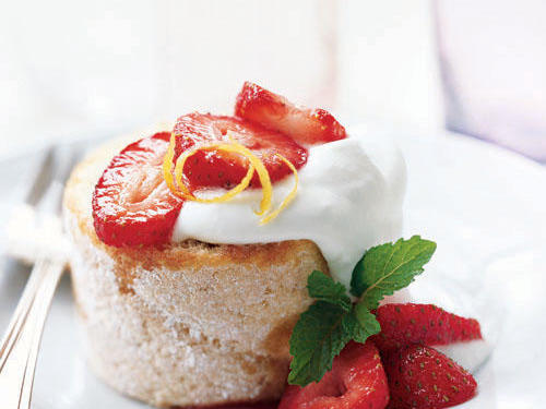 Fresh strawberries and whipped cream make this a lovely, light dessert. A curl of orange rind adds a nice garnish.