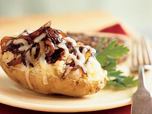 "Sure, a baked potato in its natural state (that is, sans toppings) is a very healthful food. Potatoes are naturally rich in vitamin C, potassium, and fiber. Plus, a medium-sized baked potato contains only about 160 calories. But if you're eating out, don't assume that the baked potato is the healthiest choice on the menu. Many restaurant-style baked potatoes can come ""fully loaded"" with butter, sour cream, cheese, bacon bits, and other goodies that can add up to around 600 calories and 20-plus grams of fat. Ask for one that is plain and get one or two small-portioned toppings on the side. Or try making your own healthful baked potato meal at home by adding some chopped, cooked chicken to our Caramelized Onion-Stuffed Baked Potato."