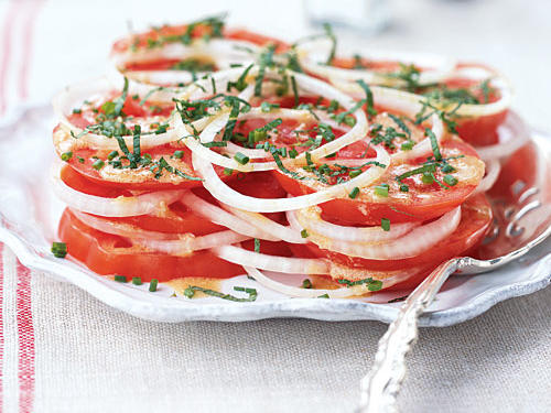 Tomatoes are an important ingredient in the Creole cooking of New Orleans. This composed salad is easy to put together yet yields abundant, fresh flavor.