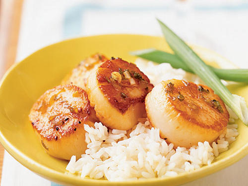 A hallmark of Asian recipes is creating deep flavor with a few simple ingredients, and this one is no exception. After searing the scallops, deglaze the pan with honey, lemon, soy sauce, and ginger to create a simple sauce whose sweet, salty, and sour flavors meld with the subtle sweetness of the scallops. A lightly cooked fresh vegetable―steamed green beans or broccoli, or sautéed bok choi or spinach―makes a perfect side.