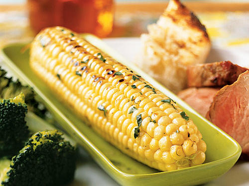 Grilling is the best way to cook corn on the cob; boiling just doesn't deliver the same intense sweetness. This recipe's tangy herbal butter adds layers of flavor to that sweet base. Try this alongside just about any
