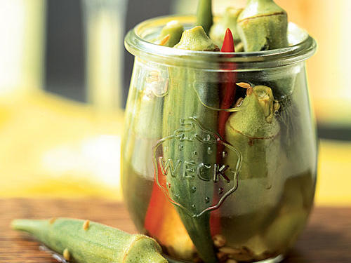 It's easier than you think to pickle your own okra, and pickling is a great way to make use of an abundant garden harvest. Serve these spicy and crunchy pods as a side dish or part of a relish tray. They're also an unusual garnish for a martini.