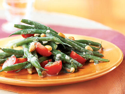 This salad tastes fresh, fresh, fresh, with a hint of tangy creaminess from the crème fraîche that also makes it feel indulgent. It's a perfect summertime dish since it relies on the sweetness of fresh green beans and tomatoes, so you should serve a summery entrée alongside it.