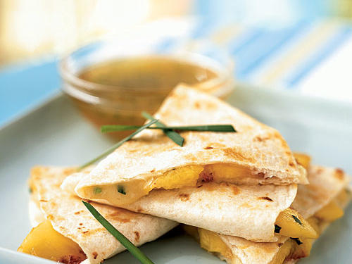 This is a decidedly different twist on the cheesy favorite, combining sweet fresh peach with mild and creamy brie. As is, it's an appetizer, but add cooked pork (which pairs excellently with peaches) to make it a meal, or serve alongside some tasty rice and beans.