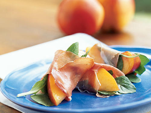 These wonderfully summery bites are a truly perfect for unexpected guests; they take all of two minutes to put together and use one of the season's best fruits. Stone fruits and pork products pair extremely well together, so you also could use plums, peaches, or apricots, with slices of ham or salami. Arugula provides crunch and bitterness to contrast the rich prosciutto and sweet fruit.