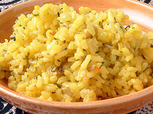 A traditional dish in Valencia, baked rice is delicious with pork or chicken. Tip: Remember to check for gluten in chicken broth.