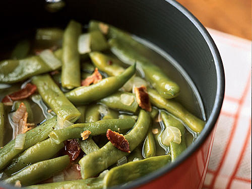 "Long, often flat, large green beans are sold in most grocery stores as ""pole beans."" Because they are tougher and more fibrous than regular green beans, cooking pole bean takes longer than common green beans. Serve this basic side dish with anything you'd normally have with green beans.
