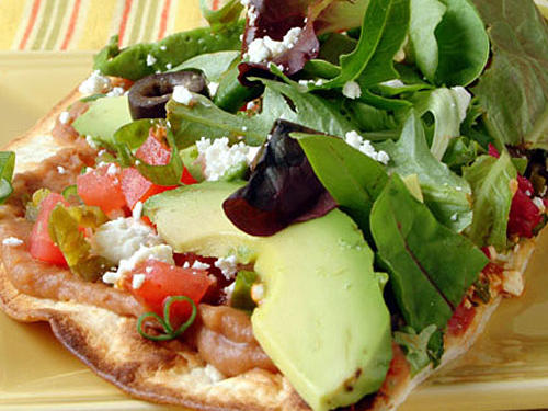 Easy to make and only 318 calories per serving, this vegetarian tostada recipe is perfect for a busy weeknight, Mexican meal.