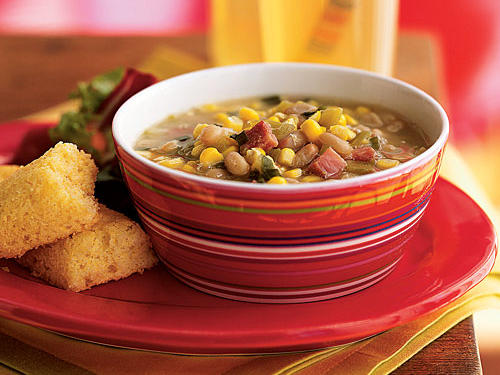 The perfect summer soup is light and full of quick-cooking, fresh, and flavorful seasonal vegetables. This hearty dish features fiber-rich navy beans, spicy green chiles, meaty ham, and crunchy sweet corn, and takes less than 10 minutes to prepare. Other summer produce like zucchini, tomatoes, and fresh herbs like cilantro or parsley would make excellent additions.