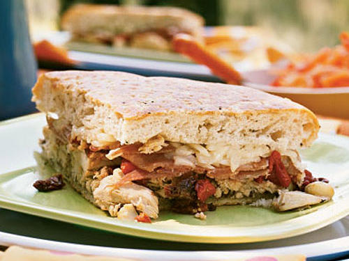 Ideal for a quick weeknight dinner or a picnic lunch, this warm, melty sandwich pairs well with sliced fruit or a bunch of grapes. Purchase roasted chicken breasts to save on preparation time.