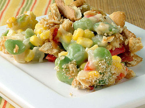 The popular combination of corn, lima beans, and bell pepper is tossed with a creamy cheese sauce and baked under a crisp cracker crumb topping. Place the crackers in a zip-top plastic bag, and crush with a rolling pin or bottle. Serve with grilled or roasted chicken.
