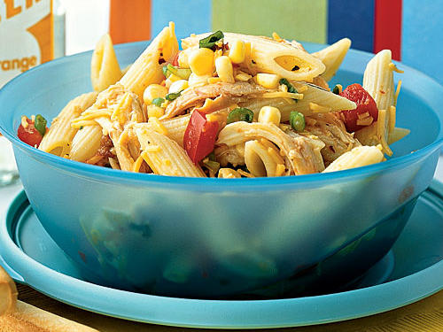 Spice things up for lunch by using intense flavors in hum-drum dishes. There's nothing boring about this pasta salad, packed with sharp Cheddar, sweet corn, and smoky chipotle. Fresh summer corn is sweet, tender, and juicy—enough so that it doesn't even require cooking. If your corn is a bit past its prime, boil it for two minutes.