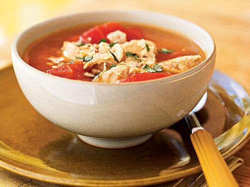 If you're intimidated by making soup, this is the recipe to show you how easy it really is. Quickly sauté the chicken, add spices, broth, and a can of tomatoes, and you're all set. A topping of crushed tortilla chips adds a unique crunchy dimension to this dish that sets it apart. Serve with corn bread or a hearty three-seed multigrain bread.