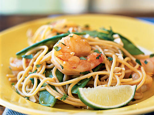 The name may sound exotic, but this dish is pretty much entirely made from common pantry items. If you have spaghetti, peanut butter, and teriyaki sauce on hand, you're good to go―the veggies and shrimp can be swapped out for any vegetable and protein. Want a two-course Thai meal? Add chicken, pork, or shrimp sate skewers as an appetizer.