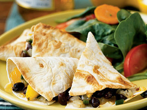 The sweetness of the mango balances the snappiness of the chile. Top quesadillas with fat-free sour cream and salsa, and serve with spinach and carrot salad.