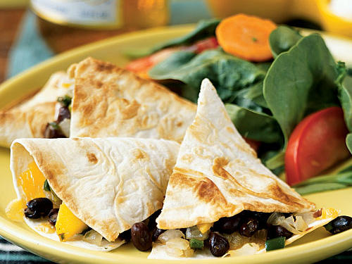 Big flavor and lots of gooey melted cheese, but less than 10 grams of fat? Fantastic! The tart, juicy sweetness of mango and the fire of poblano combine to make every bite of these quesadillas a treat. They also make a great hors d'oeuvre for a summertime party.