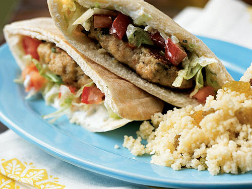Lots of flavors―green onion, seasoned breadcrumbs, lemon, and Greek seasoning―make sure these burgers are anything but bland. The easy lemony spiced yogurt is also great with falafel, lamb, or really anything on a pita. Serve with a simple cucumber salad or flavorful couscous.