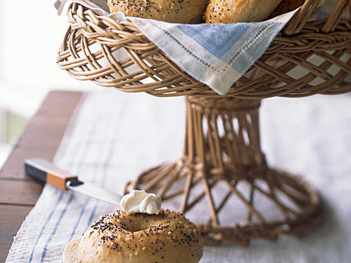 Restaurant bagels can weigh in at a hefty 350 to 400 calories; but these home-baked bagels, infused with the rich yeasty flavor of beer, are a welcome breakfast treat at just 211 calories. To achieve the signature chewy texture, the bagels are boiled and then baked in a simple process that will warm up your kitchen on a chilly afternoon. Package in a brown paper bag.