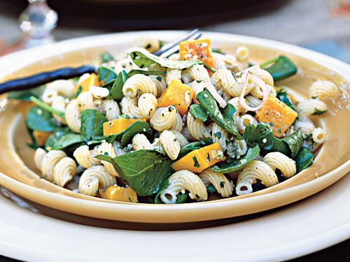 Pasta salad isn't just for summer. Butternut squash and a walnut-sage pesto give this dish a hit of fall flavor. The pesto sauce darkens upon standing, so try to serve the salad shortly after tossing the ingredients.