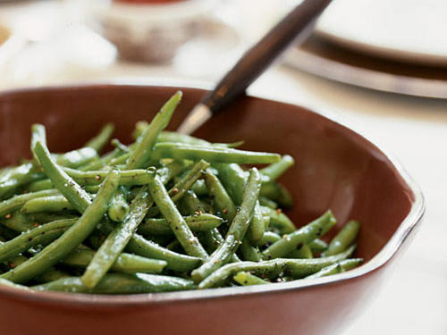 This easy vegetable side dish adds color to the meal, and you can roast the green beans at the last minute while you finish setting the table.