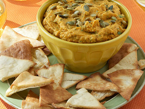 This appetizer recipe offers a fall-style twist on the traditional Middle Eastern spread. You can find pumpkinseeds—also called pepitas—in groceries and Mexican markets. Prepare this pumpkin hummus recipe up to a day ahead, and refrigerate.