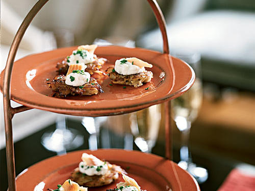 Classic Hanukkah latkes form the base for this intriguingly flavored appetizer. Seemingly incongruous tart apple and spicy horseradish flavors unite to balance the strongly flavored smoked trout, all atop a crunchy-starchy pancake foundation.