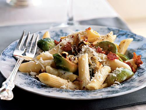Not every holiday meal has to feature a big hunk of meat at the center of the table. This dish encapsulates fall flavor with steamed Brussels sprouts and crunchy hazelnuts, a creamy Parmesan sauce, and just a little bit of bacon. To make this a vegetarian-friendly entrée, use vegetable broth instead of chicken, and serve the crumbled bacon on the side.