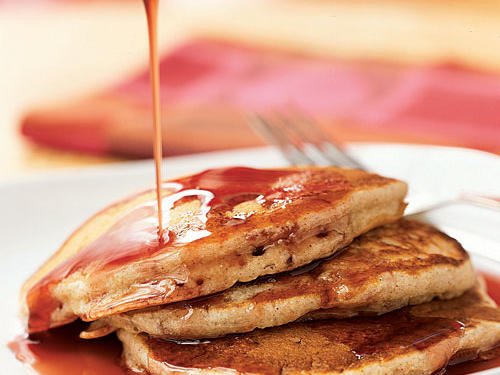 This recipe is a delightful combination of fruity flavors. The pairing of banana pancakes with pomegranate syrup is a healthy way to start your morning.