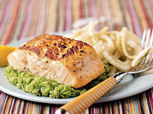 This light-and-fresh dish has a wonderful spring feeling to it, but you can make it any time of the year. Simply seasoned salmon shows off its flaky texture atop a unique side―mashed green peas with basil, tarragon, and lemon. The color is gorgeous, the flavor fresh, and the texture creamy, but the best part is the peas are much more healthful than starchy mashed potatoes loaded down with butter, cream, and salt.