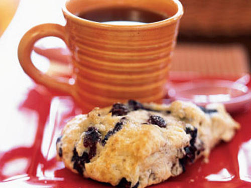 Make these scones a day or two ahead, and store in an airtight container. Resist the temptation to knead the dough; doing so would break apart the tender blueberries. Leftover scones are nice with tea later in the day.