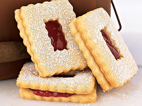 "Use a heart-shaped cookie cutter to say ""I love you"" with our Raspberry Linzer Windowpane Cookies (pictured)."