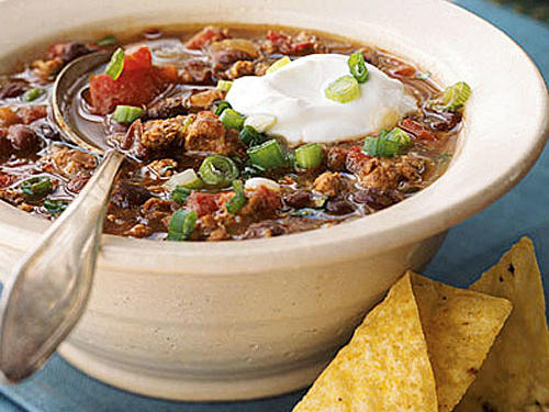 "This southwestern-style chili is perfect for make-ahead meals. If you make this chili recipe in advance, you may need to thin the chili with water or no-salt-added broth when you reheat it. To save time, combine the sausage ingredients in advance, and finish the chili later. Reviewer AlaskaCook said, ""I've been making this chili since it was first published and it's a favorite in the family. Making the sausage the night before is worth the pre-planning. Since we don't eat ground beef, I love that this recipe uses ground turkey and ground pork."""