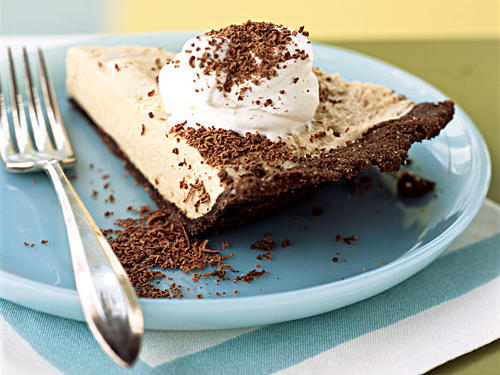 Boiling coffee down to a concentrated syrup, then mixing it with milk in an airy chiffon filling makes this chocolate-graham-cracker-crusted pie a dessert that's sure to give you a buzz.