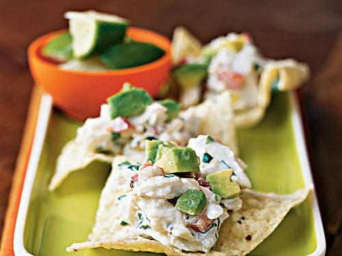 An easy crab salad that has tons of flavor―it includes tangy lime, fiery chipotle, creamy avocado, and crunchy vegetables―is baked on tortilla chips for a unique appetizer. To make it a meal, omit the chips and bake the crab mixture in a baking dish, then serve over lettuce as a main-dish salad, or fill warmed flour tortillas for chipotle-lime crab tacos.
