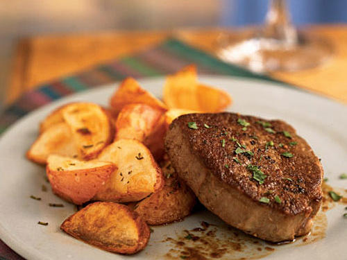 The bourbon and a small amount sugar round out the sharp coffee flavor to make a rich sauce for the beef. Roast refrigerated potato wedges for a quick side.