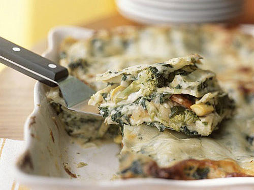 Vegetable lasagna is a crowd-pleaser and a classic make-ahead dish. You can use precut onions, matchstick-cut carrots, and broccoli, in addition to precooked noodles, to speed up preparation.
