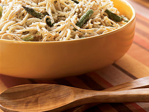The contrasting colors of whole-wheat and regular pasta give this dish its unusual name, but the creamy sauce is pure classic. We use a combination of milk and cream cheese to lighten our alfredo, which adds a nice tangy element to the sauce. Fresh asparagus, roasted very simply, provides color and texture contrast and also lends great springtime flavor to the dish. You can substitute broccoli if asparagus isn't available.