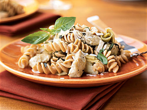 Work new, healthful whole grains into your diet with this recipe. Kamut pasta should be near the regular pastas at the supermarket―use whole-wheat or another whole-grain pasta like spelt or quinoa if you can't find it. The flavorful sauce, with acidic notes from the wine and grassy ones from the artichokes, combines with the hearty noodles to make a hearty dish. A topping of fresh basil and lots of Parmesan seals the deal.