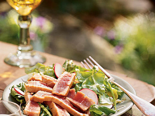 The slightly sweet tenderness of barely-seared tuna matches the sweet-and-peppery crunch of radishes in this elegant salad. The unique dressing uses silken tofu for creamy texture without fat and has a pungent horseradish heat. If wild salmon is in season, it's great in this dish as well.