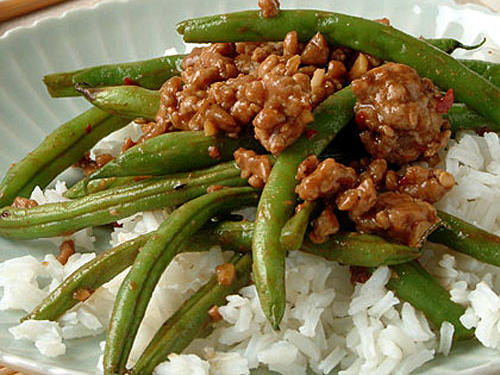 This recipe is characteristic of the hot and spicy cuisine from the Szechuan province. You can substitute lean ground chicken or turkey for pork and asparagus for green beans, if you prefer.
