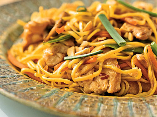 Chow mein noodles have a nice chewy texture that's a great match for the tender chicken and crunchy carrot and snow peas in this recipe. It's the same savory Chinese-American dish you can get at any restaurant, but our version has less than two grams of saturated fat per serving. Asian-flavored sautéed greens, like spinach or bok choy, are an excellent side.