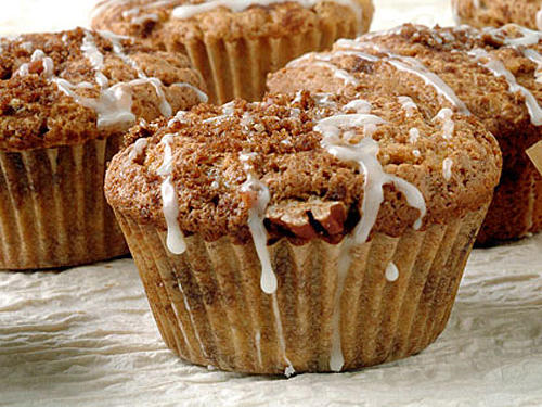 Coffee cake in individualized servings will revolutionize your next breakfast gathering. Fold the batter just four times to swirl in the sugar mixture, not fully blend it.